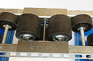 The 'indirect' speed controller is designed for lanes using skate wheel or larger polycarbonate wheel tracks. This method allows for a typical load weight variance in the lane of approximately 1,500#.